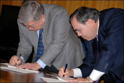 Martin and McNeil signing agreement